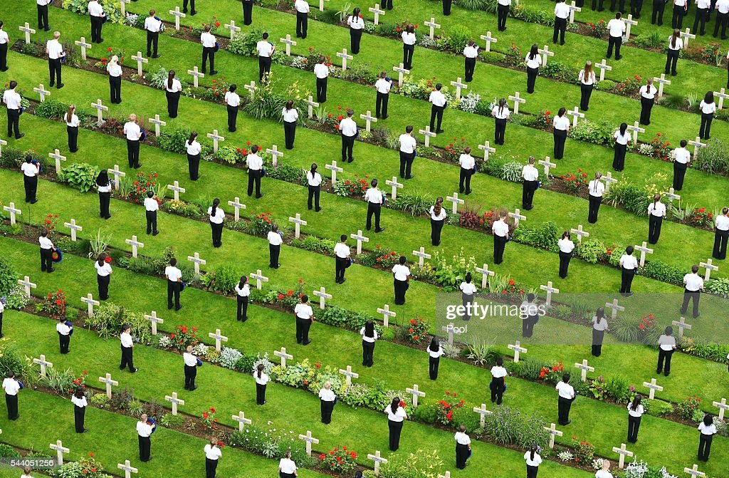Young people lay wreaths during a service to mark the 100th anniversary of the start of the battle of the Somme at the Commonwealth War Graves Commission Memorial on July 1, 2016 in Thiepval, France. The event is part of the Commemoration of the Centenary of the Battle of the Somme at the Commonwealth War Graves Commission Thiepval Memorial in Thiepval, France, where 70,000 British and Commonwealth soldiers with no known grave are commemorated.