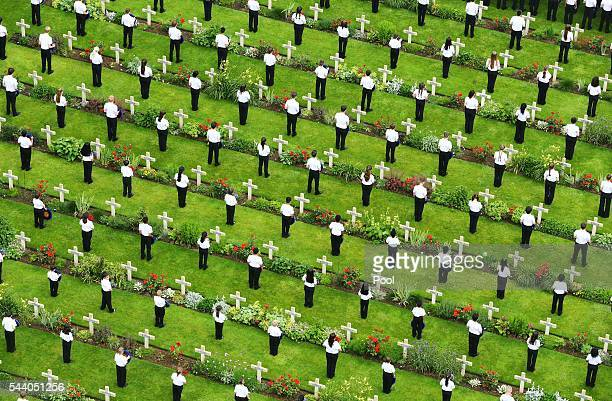 Young people lay wreaths during a service to mark the 100th anniversary of the start of the battle of the Somme at the Commonwealth War Graves...