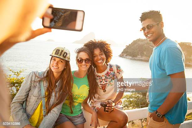 Young people looking taking photo in Niteroi, Rio de Janeiro, Brazil