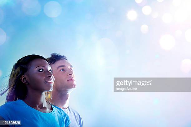 Young people looking up at light