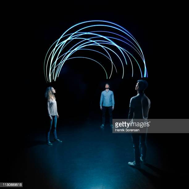 young people looking up at lighttrace arches - bonding stock pictures, royalty-free photos & images