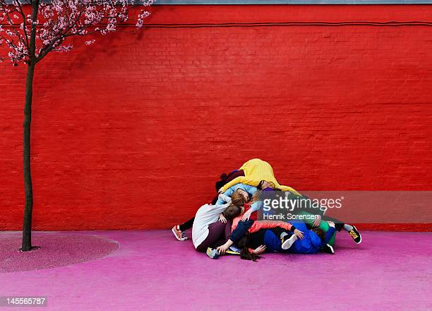 young people lying in a pyle - girl mound stock pictures, royalty-free photos & images
