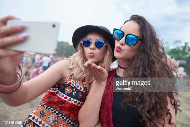 Young people making selfie at music festival