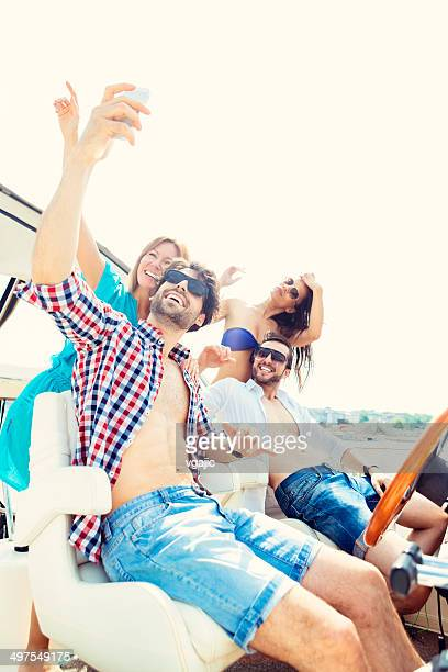 Young People Making Selfie on the Yacht and having fun.