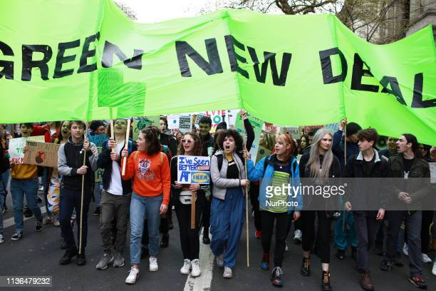 Young people march along Whitehall calling for a 'Green New Deal' during the third climate 'youth strike' in London England on April 12 2019 The...