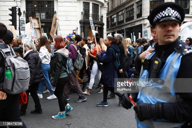 Young people march up Regent Street during the third climate 'youth strike' in London England on April 12 2019 The event was organised as part of the...