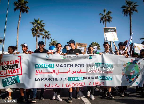 Young people march with a banner as they take part in the Youth March for the Climate demonstration part of a worldwide climate strike against...