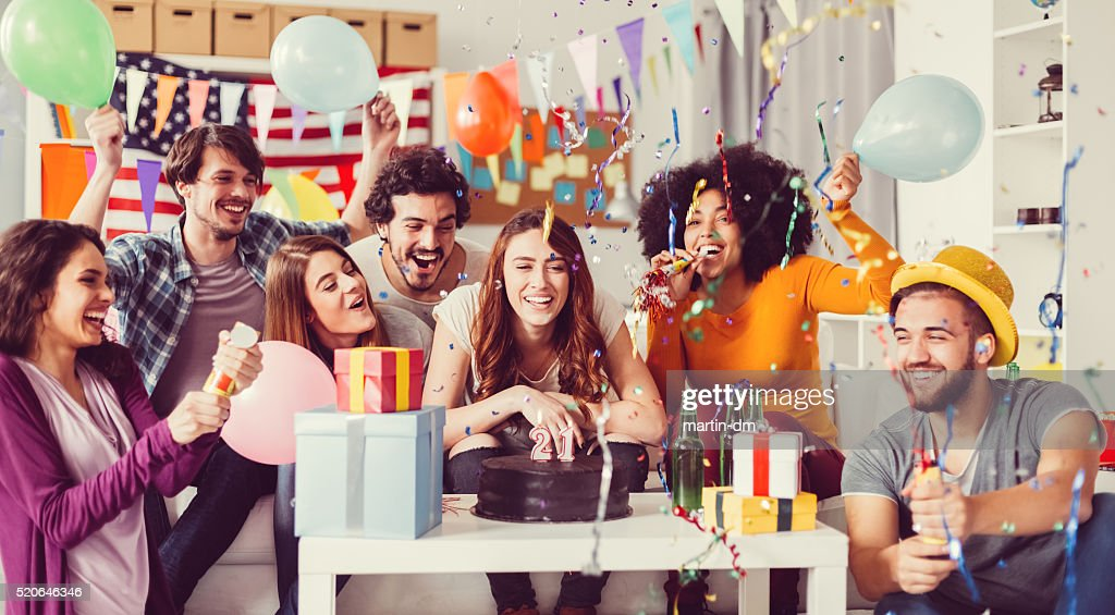 Young people on a birthday party in the office : Stock Photo