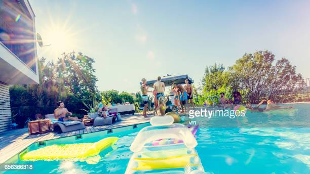 young people on a pool party - pool party stock pictures, royalty-free photos & images