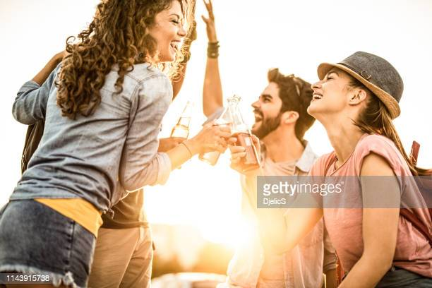 young people on a summer music festival. - cider stock pictures, royalty-free photos & images