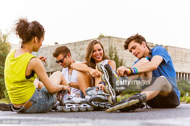 young people on rollerblades - inline skate stock photos and pictures