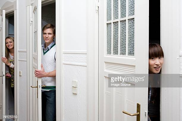 Young people opening doors
