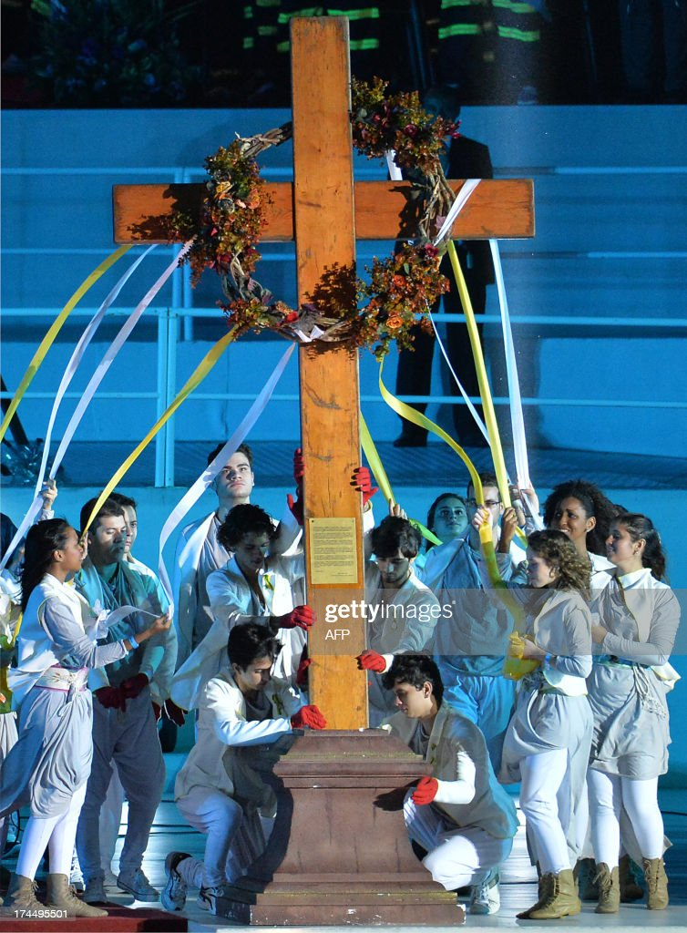 Young people participate in the re-enactment of the 14 Stations of the Cross -- scenes of Jesus carrying the cross to his crucifixion -- with the participation also of Pope Francis, at Copacabana beach in Rio de Janeiro, on July 26, 2013. Pope Francis, who is in Rio for the weeklong gathering of young Catholics World Youth Day, took his high-octane mission to 'shake up' Catholic faith back to the streets of Brazil Friday, greeting throngs of pilgrims, meeting convicts and hearing youngsters confess their sins.