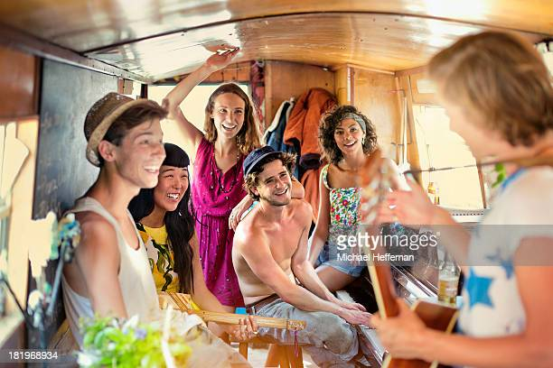 young people party inside canal boat