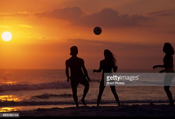Young people play soccer at Ipanema beach during sunset outdoor recreation at the Rio de Janeiro summer Brazil