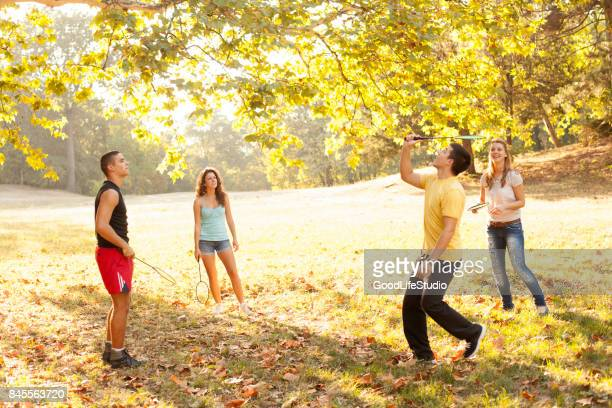 young people playing badminton - racket sport stock pictures, royalty-free photos & images