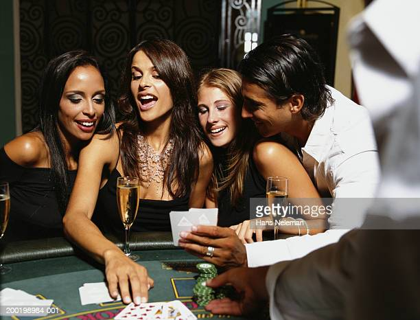 Young people playing cards at casino