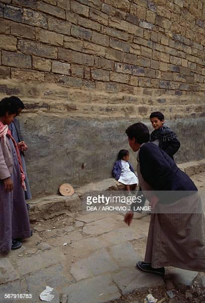 Young people playing darts Thula Yemen