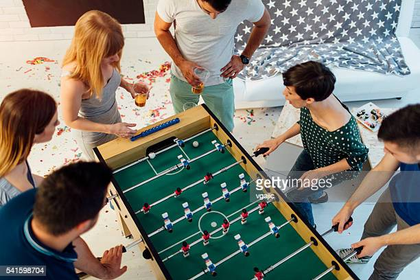 Young People Playing Foosball.