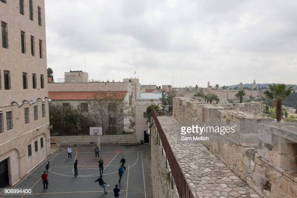 Young people playing football below Ramparts Walk on 31st March 2016 in Jerusalem West Bank