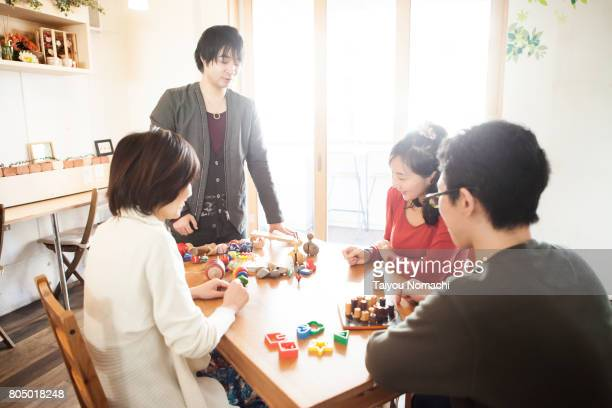 Young people playing games at a cafe