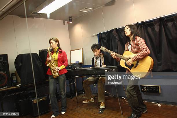 young people playing instruments - electric piano stock photos and pictures