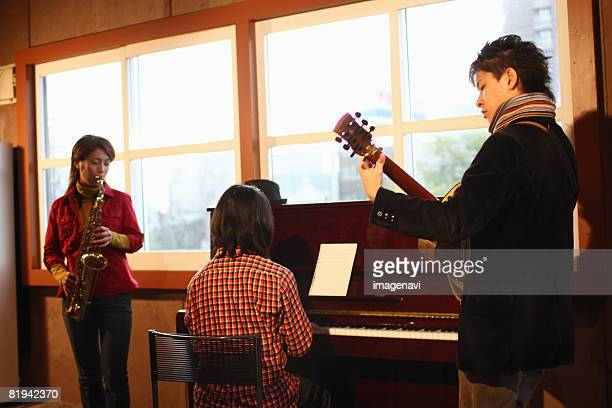 Young people playing instruments