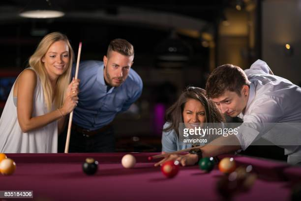 young people playing pool in pub