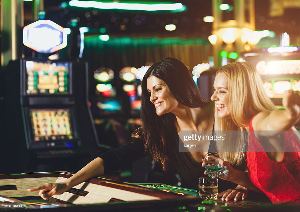 Young people playing roulette at the casino : Stock Photo