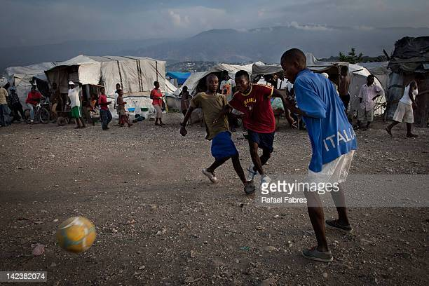 Young people playing soccer in one tent camp in the neightborhood of Cite Soelil on the 02nd of April 2012 in Port Au Prince Haiti In the northern...