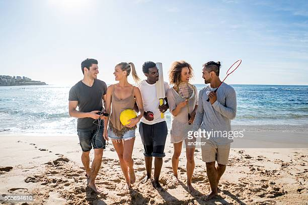 Young people playing sports at the beach