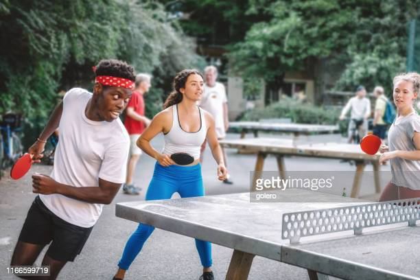 young people playing table tennis round around - table tennis stock pictures, royalty-free photos & images