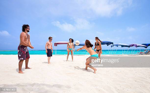 Young people playing Voleyball on a beach