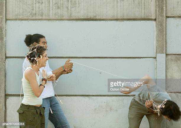 Young people playing with party string