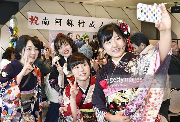 Young people pose for photos during a comingofage ceremony on Jan 3 in the earthquakeaffected southwestern Japan village of Minamiaso More than 20...