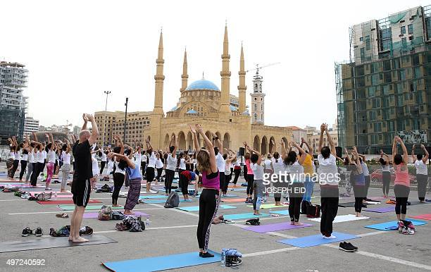 Young people practice yoga in Beirut's Martyrs Square in the heart of the Lebnese capital on November 15 2015 The special 108 Sun Salutations event...