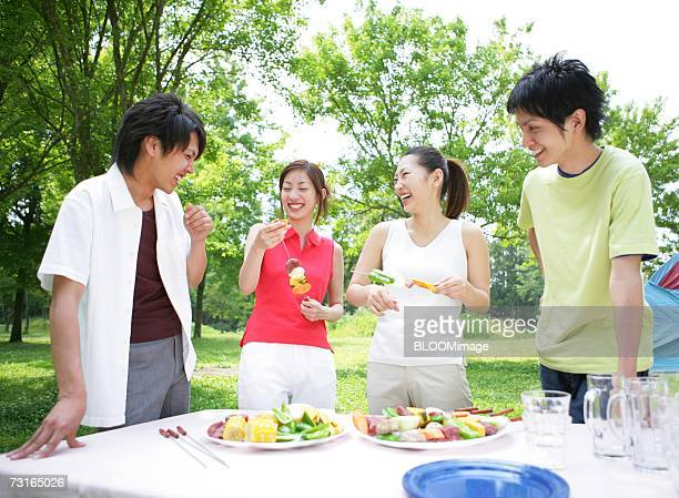 Young people preparing for barbecue