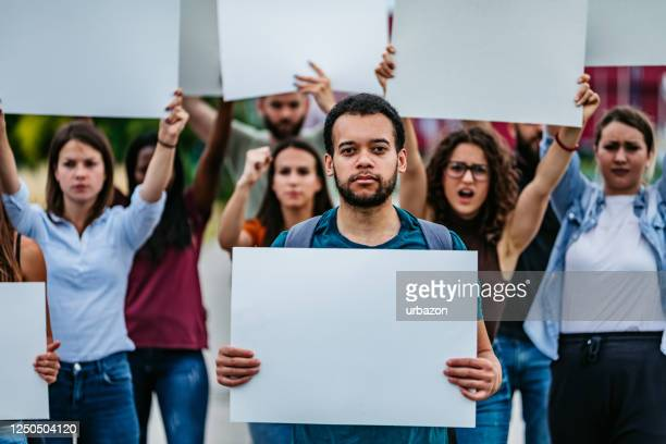 young people protesting at the street - campaigner stock pictures, royalty-free photos & images