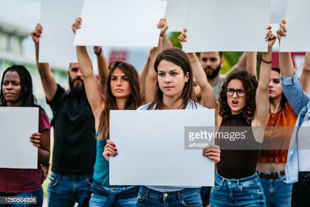 young people protesting at the street - political rally stock pictures, royalty-free photos & images