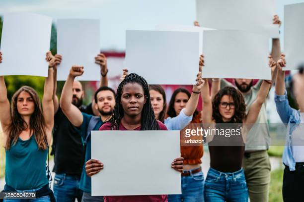 young people protesting at the street - marching stock pictures, royalty-free photos & images