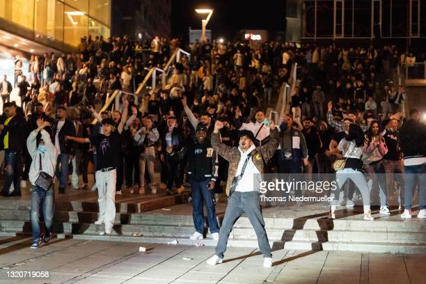 Young people provoke the police on May 29, 2021 in Stuttgart, Germany. Partygoers, mostly young men, gathered in the city center, with little regard...