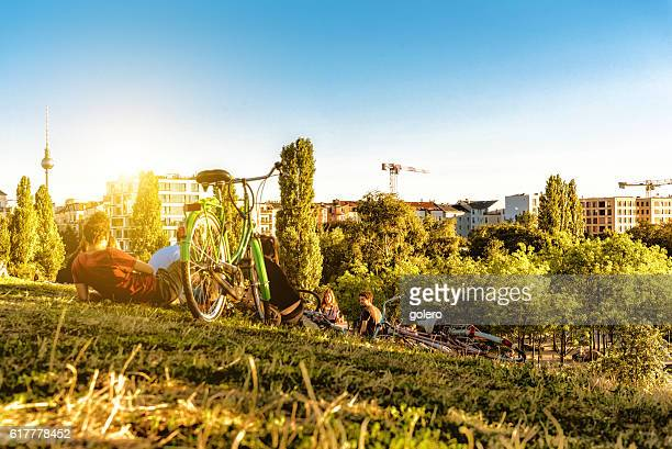 young people relaxing in berlin mauerpark - central berlin stock pictures, royalty-free photos & images
