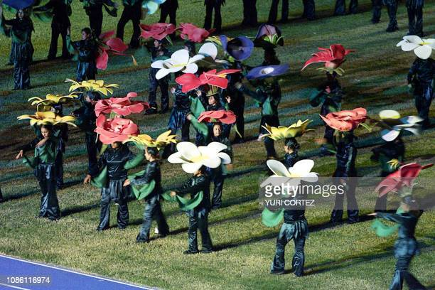 Young people representing flowers act in the National Stadium of Flora Blanca 23 November 2002 during the opening ceremony of the XIX Central...