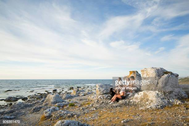 young people resting at seaside - gotland bildbanksfoton och bilder