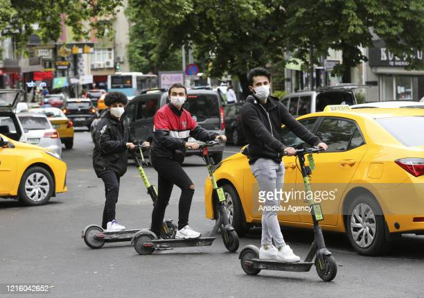 Young people ride scooters at street after youths between 15-20 years across Turkey allowed to leave their homes, remaining within walking distance...