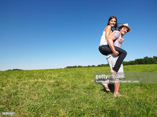 young people riding piggy back