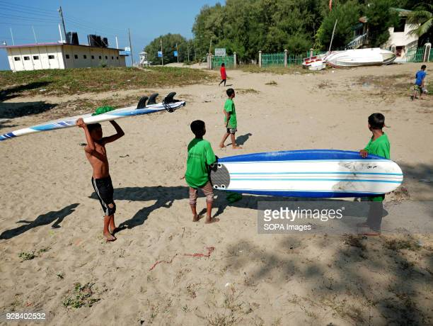 Young people seen preparing their surfboards at the beach Young people in the world´s longest sandy beach in Cox´s Bazar Bangladesh decided to throw...