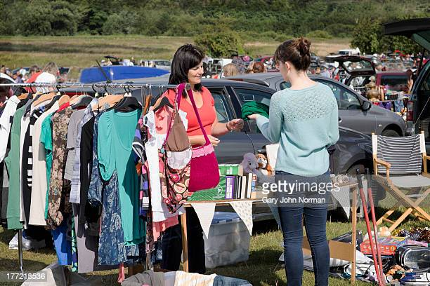 young people selling at car boot sale