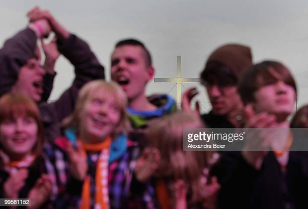 Young people sing during a concert at the fourth day of the 2nd ecumenical Kirchentag on May 15 2010 in Munich Germany