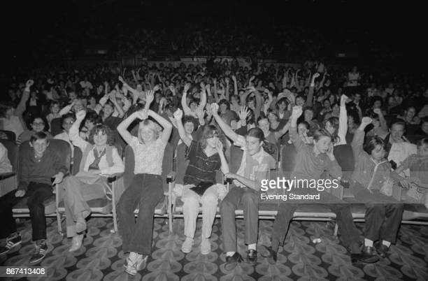 Young people sit in a cinema for the screening of American musical romantic comedy film 'Grease' UK 11th September 1978